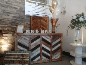 Reception Bar with Chevron paels and an L shape attachment for ice bucket.