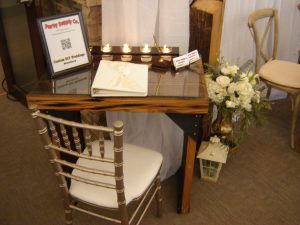 Gold Chiavari Chair shown with 200 Year old Douglas Fir signing table.