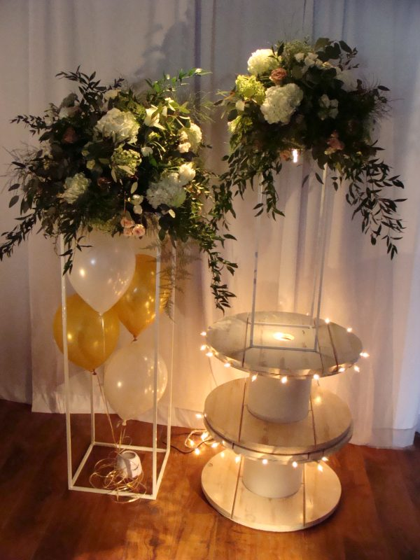 Wrought Iron Stand and floral, balloons and lighting options.