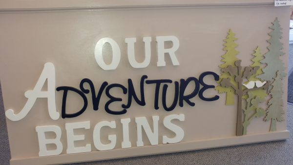 "Signage ""Our Adventure Begins"" Party Supply Co."